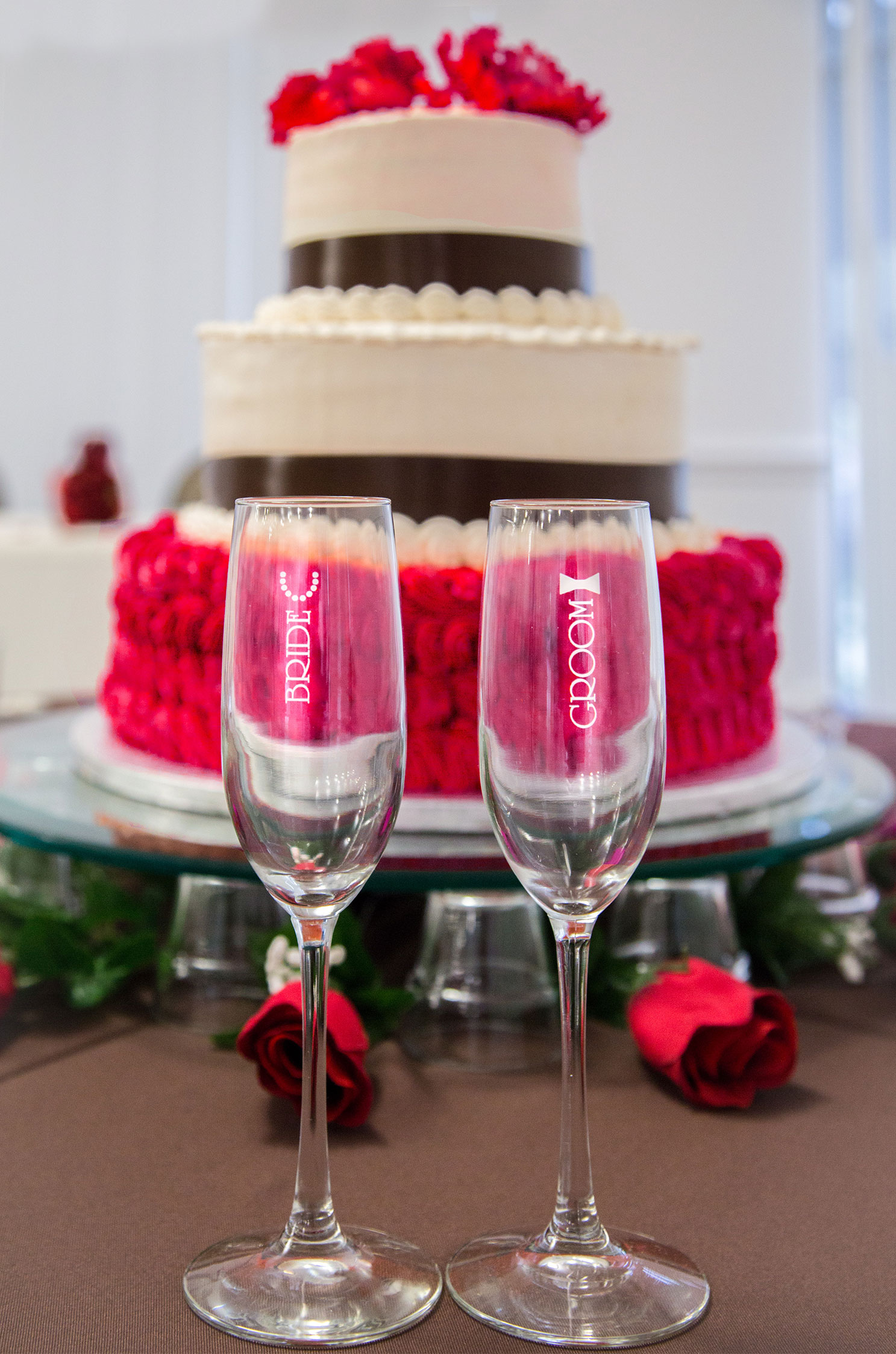 Champagne Glasses In Front Of A Wedding Cake