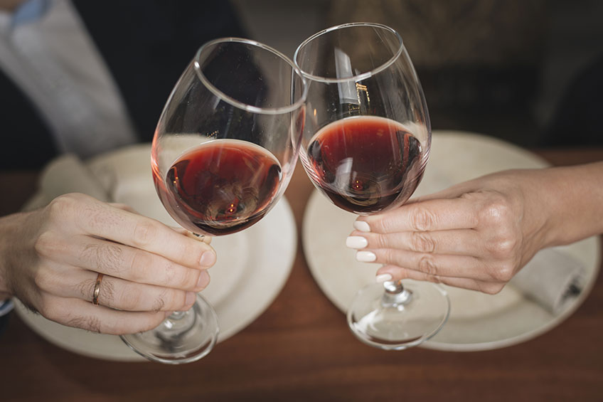 Red Wine In Glasses Clinking Together