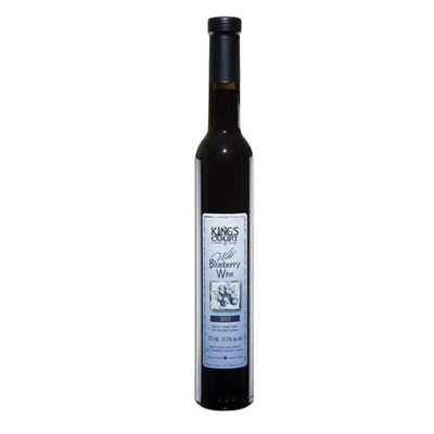 A bottle of 2015 Wild Blueberry wine on a plain background
